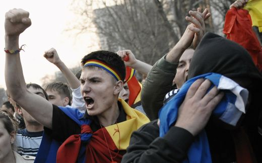 Young people shout during a rally in Chisinau on April 6, 2009. About 10,000 demonstrators gathered in the Moldovan capital Chisinau to protest against the results of a parliamentary election which the ruling Communist Party won. AFP PHOTO / VADIM DENISOV (Photo credit should read VADIM DENISOV/AFP/Getty Images)